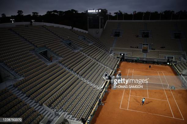 Britain's Johanna Konta returns the ball to Cori Gauff of the US during their women's singles first round tennis match on Day 1 of The Roland Garros...