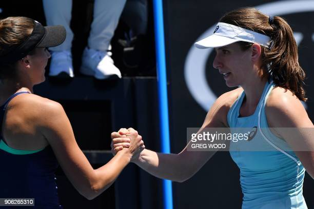 Britain's Johanna Konta shakes hands with Bernarda Pera of the US after defeat during their women's singles second round match on day four of the...