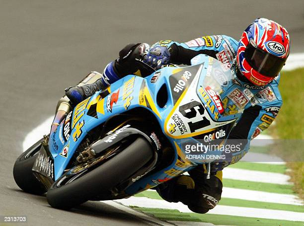 Britain's John Reynolds riding a Suzuki GSX1000R leans into Sterlings Bend during the final qualifying session at The Superbike World Championship at...