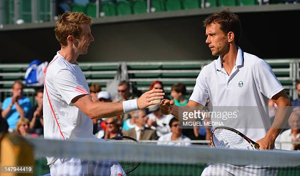Britain's Jonathan Marray and Denmark's Frederik Nielsen celebrate during their men's doubles semifinal victory over US player Bob Bryan and US...