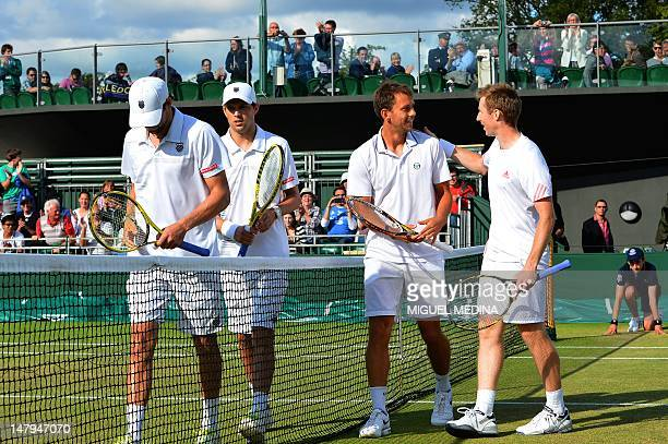 Britain's Jonathan Marray and Denmark's Frederik Nielsen celebrate their men's doubles semifinal victory over US player Bob Bryan and US player Mike...