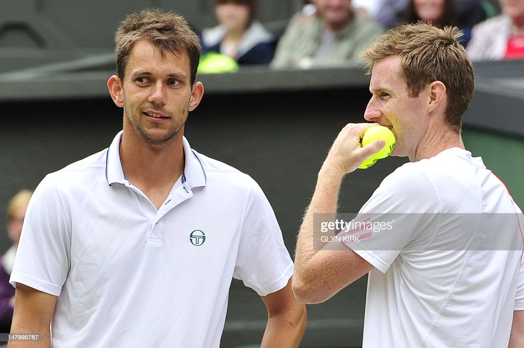 Britain's Jonathan Marray (R) and Denmark's Frederik Nielsen (L) talking during their men's doubles final match against Swedan's Robert Lindstedt and Romania's Horia Tecau on day 12 of the 2012 Wimbledon Championships tennis tournament at the All England Tennis Club in Wimbledon, southwest London, on July 7, 2012.