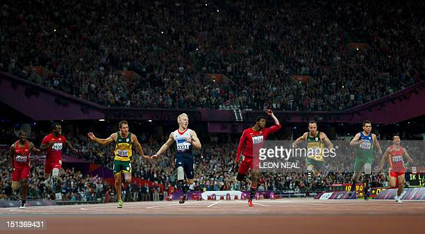 Britain's Jonnie Peacock crosses the line first to win ahead of US athlete Jerome Singleton US athlete Blake Leeper South Africa's Arnu Fourie US...
