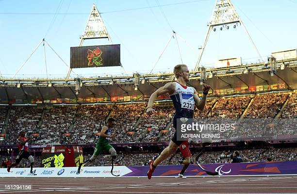 Britain's Jonnie Peacock powers home to win the men's 100m T44 heat 1 during the athletics competition at the London 2012 Paralympic Games at the...