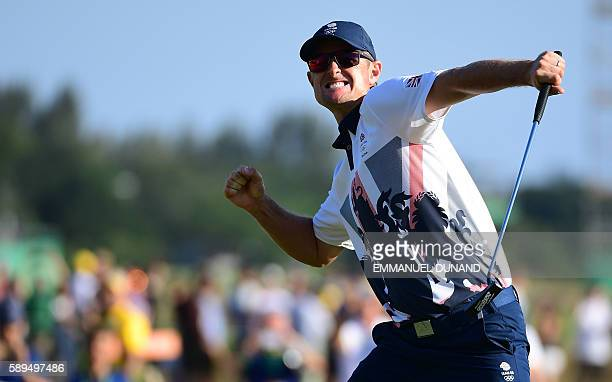 Britain's Justin Rose celebrates his victory in the men's individual stroke play final day at the Olympic Golf course during the Rio 2016 Olympic...