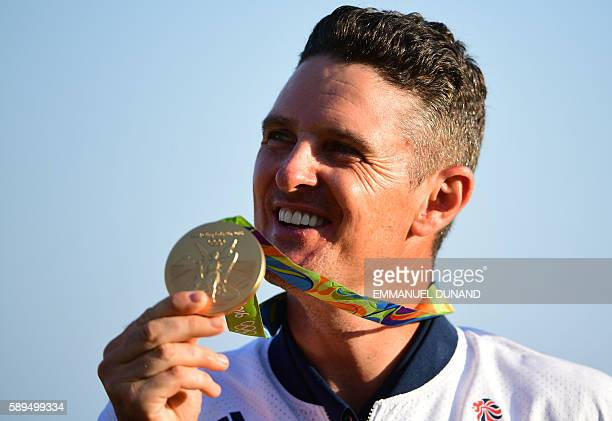 Britain's Justin Rose poses with his gold medal in the men's individual stroke play final day at the Olympic Golf course during the Rio 2016 Olympic...