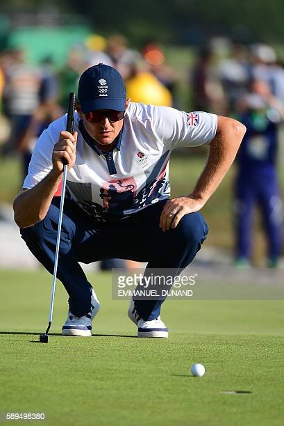 Britain's Justin Rose prepares to put for Eagle on the 18th and win the Gold medal in the men's individual stroke play final day at the Olympic Golf...