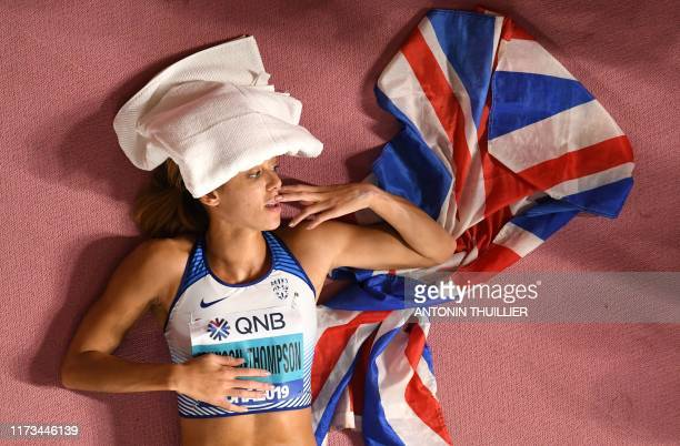 TOPSHOT Britain's Katarina JohnsonThompson celebrates after winning the Women's Heptathlon at the 2019 IAAF Athletics World Championships at the...