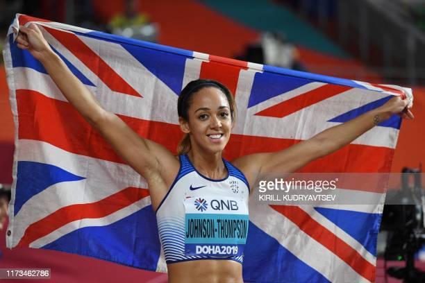 Britain's Katarina JohnsonThompson celebrates after winning the Women's Heptathlon at the 2019 IAAF Athletics World Championships at the Khalifa...