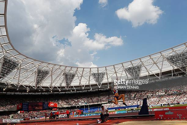 Britain's Katarina JohnsonThompson competes in the women's long jump during the IAAF Diamond League Anniversary Games athletics meeting at the Queen...