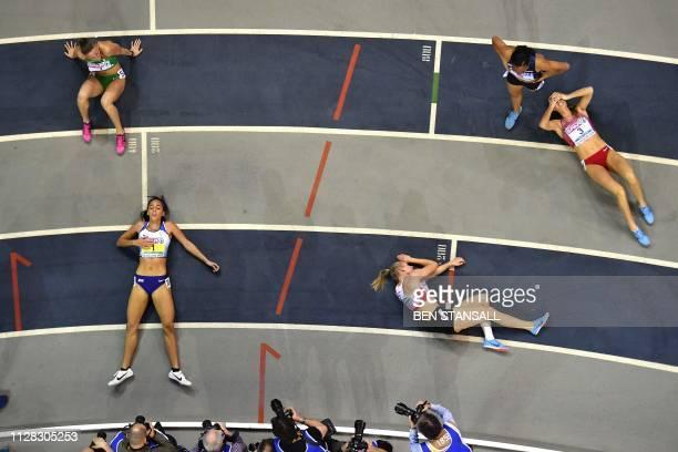TOPSHOT Britain's Katarina JohnsonThompson reacts after winning the womens 800m pentathlon final at the 2019 European Athletics Indoor Championships...