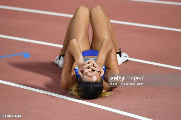 TOPSHOT Britain's Katarina JohnsonThompson reacts after winning the Women's 800m Heptathlon final at the 2019 IAAF Athletics World Championships at...