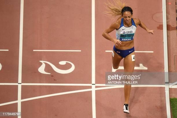 TOPSHOT Britain's Katarina JohnsonThompson wins the Women's 800m Heptathlon final at the 2019 IAAF Athletics World Championships at the Khalifa...