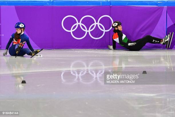 Britain's Kathryn Thomson and Hungary's Andrea Keszler crash in the women's 500m short track speed skating heat event during the Pyeongchang 2018...