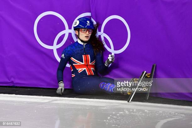 Britain's Kathryn Thomson reacts after crashing in the women's 500m short track speed skating heat event during the Pyeongchang 2018 Winter Olympic...
