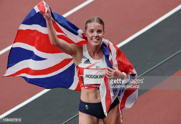 Britain's Keely Hodgkinson celebrates after winning silver in the women's 800m final during the Tokyo 2020 Olympic Games at the Olympic Stadium in...
