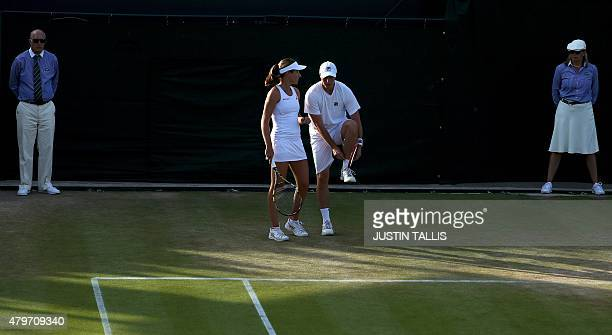 Britain's Ken Skupski and Britain's Johanna Konta confer during their mixed doubles second round match against Canada's Daniel Nestor and France's...