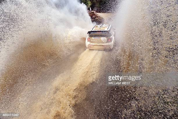 Britain's Kris Meeke powers through a water crossing in his Citroen on the final day of the World Rally Championship Rally of Australia near...