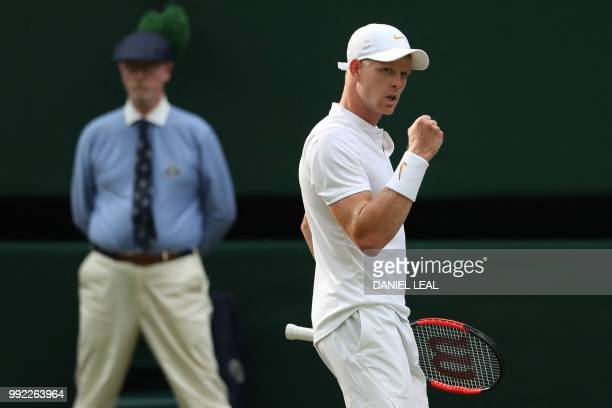 Britain's Kyle Edmund celebrates a point against US player Bradley Klahn in their men's singles second round match on the fourth day of the 2018...