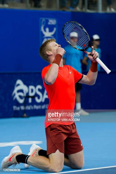 Britain's Kyle Edmund celebrates after winning his tennis match against France's Gael Monfils in the final of the 'European Open' hard court tennis...