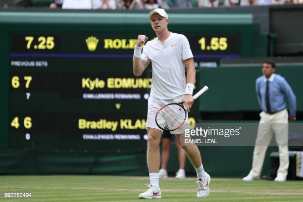 Britain's Kyle Edmund celebrates beating US player Bradley Klahn 64 75 62 in their men's singles second round match on the fourth day of the 2018...