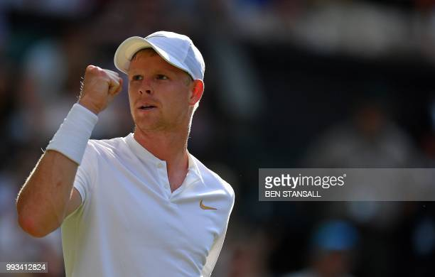 Britain's Kyle Edmund celebrates winning a point against Serbia's Novak Djokovic during their men's singles third round match on the sixth day of the...