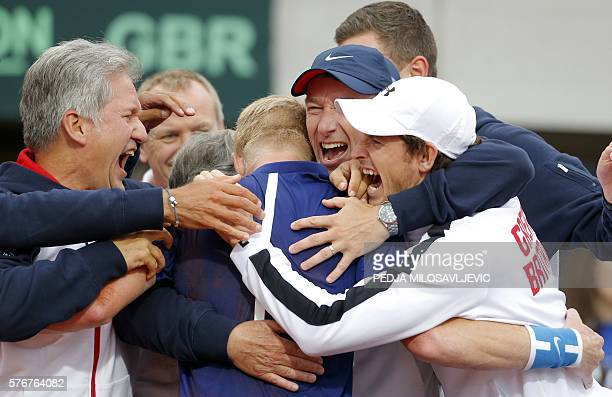 Britain's Kyle Edmund celebrates with Andy Murray and other teammates after beating Serbia during the Davis Cup World Group quarter final match at...