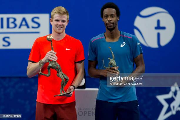 Britain's Kyle Edmund holds his trophy after beating France's Gael Monfils in the final of the 'European Open' hard court tennis tournament in...