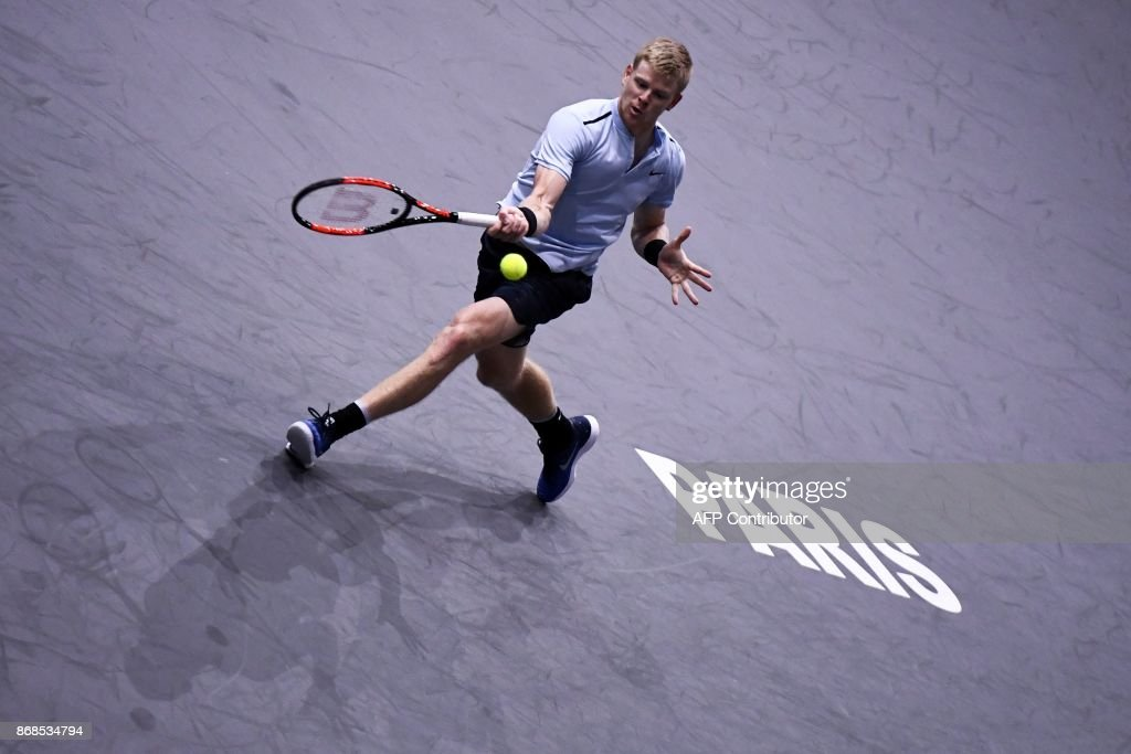Britain's Kyle Edmund returns the ball to Russia's Evgeny Donskoy during their first round match at the ATP World Tour Masters 1000 Indoor tennis tournament on October 31, 2017 in Paris. /