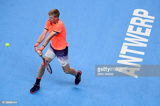 Britain's Kyle Edmund returns the ball to Spain's David Ferrer during their second round match at the ATP European Open tennis tournament in Antwerp...