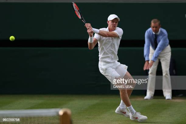 Britain's Kyle Edmund returns to US player Bradley Klahn in their men's singles second round match on the fourth day of the 2018 Wimbledon...