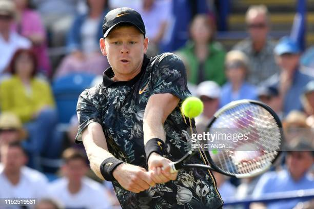Britain's Kyle Edmund returns to US player Taylor Fritz during their men's singles semifinal match at the ATP Nature Valley International tennis...
