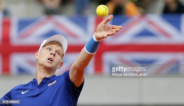 Britain's Kyle Edmund serves the ball to Serbia's Janko Tipsarevic during the Davis Cup World Group quarter final single match between Serbia and...