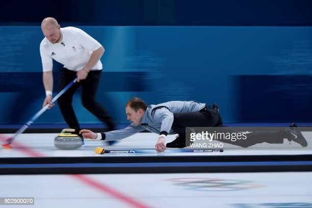 Britain's Kyle Smith throws the stone during the curling men's tiebreaker game during the Pyeongchang 2018 Winter Olympic Games at the Gangneung...