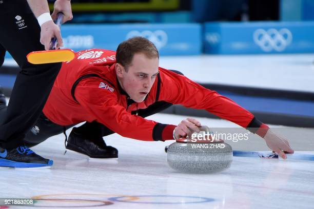 Britain's Kyle Smith throws the stone during the curling men's round robin session between Britain and the US during the Pyeongchang 2018 Winter...