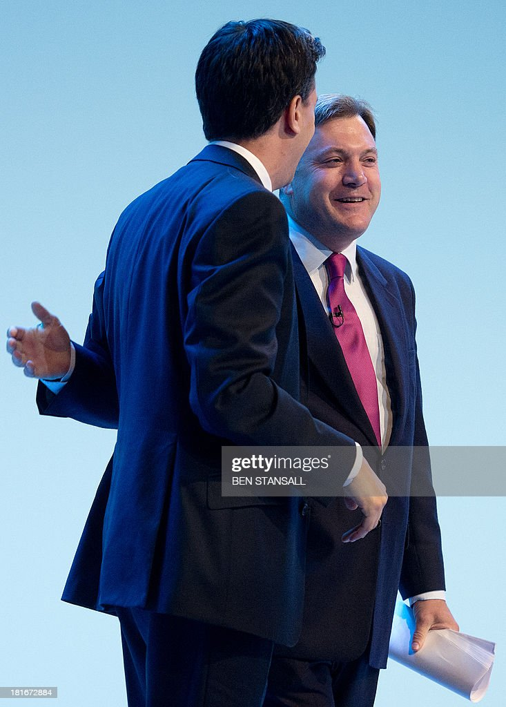 Britain's Labour party leader Ed Miliband (L) applauds shadow chancellor Ed Balls (R) following his speech on the second day of the Labour party conference in Brighton, Sussex, south England on September 23, 2013. Britain's main opposition Labour party kicked off its annual conference on September 22 with leader Ed Miliband under pressure amid sliding poll ratings 18 months before a general election.