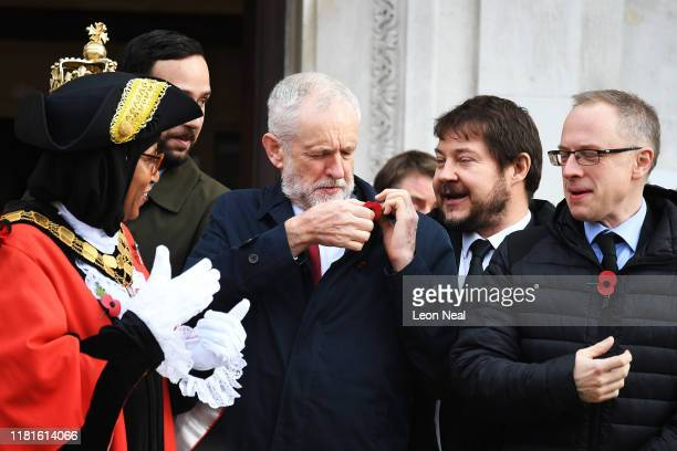 Britain's Labour Party leader Jeremy Corbyn adjusts his poppy as he attends the Armistice Day Commemoration at Islington Town Hall to mark Armistice...
