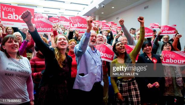 Britain's Labour Party leader Jeremy Corbyn cheers with Labour Parliamentary Candidate for Gloucester Fran Boait and supporters as he joins a local...