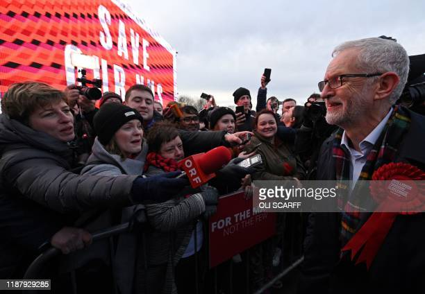 Britain's Labour Party leader Jeremy Corbyn greets supporters and members of the media during a general election campaign event in Stainton Village...