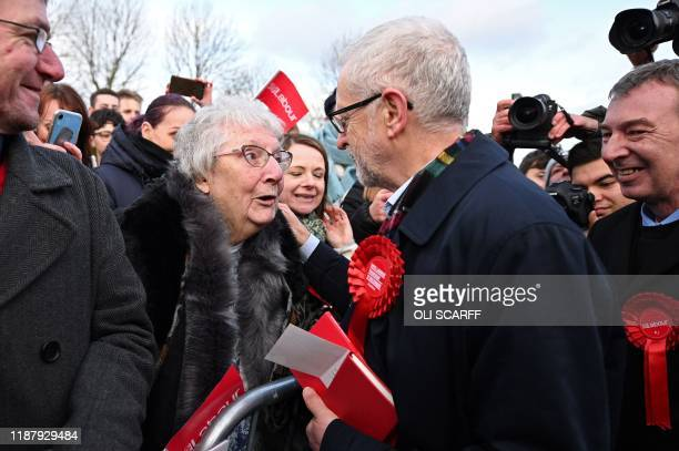 Britain's Labour Party leader Jeremy Corbyn greets supporters during a general election campaign event in Stainton Village near Middlesbrough north...