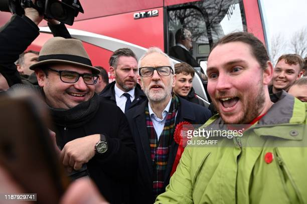 Britain's Labour Party leader Jeremy Corbyn poses for selfie photographs as he greets supporters during a general election campaign event in Stainton...