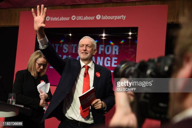 Britain's Labour Party leader Jeremy Corbyn waves as he acknowledges the applause after speaking at the launch of the Labour party election manifesto...