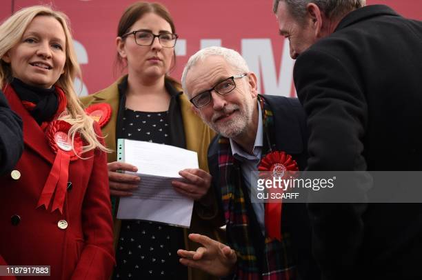 Britain's Labour Party leader Jeremy Corbyn waves as he attends a general election campaign event in Stainton Village near Middlesbrough north east...