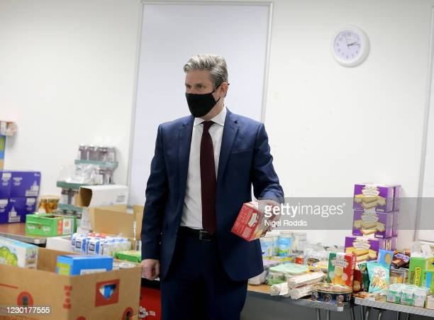 Britain's Labour Party Leader Keir Starmer packs food parcels for residents during a visit to Lightwaves Leisure Centre on December 17, 2020 in...