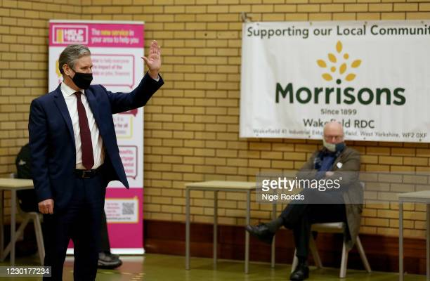 Britain's Labour Party Leader Keir Starmer speaks to residents during a visit to Lightwaves Leisure Centre on December 17, 2020 in Wakefield,...