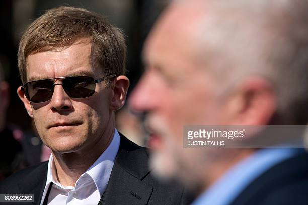 Britain's Labour Party's Executive Director of Strategy and Communications Seumas Milne watches as British Labour party Leader Jeremy Corbyn gives a...