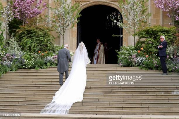 Britain's Lady Gabriella Windsor walks with her father, Britain's Prince Michael of Kent, before her wedding ceremony to Thomas Kingston at St...