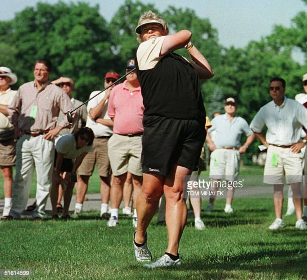 Britain's Laura Davies makes an approach shot from the rough off of the 11th fairway in the first round of play in the LPGA Championship at the...