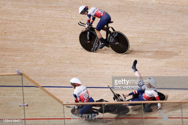 Britain's Laura Kenny looks as Britain's Neah Evans and Britain's Katie Archibald crashes after setting world record in the first round heats of the...