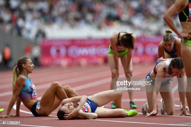 Britain's Laura Muir and fellow runners react on the track after the women's 1 mile during the IAAF Diamond League Anniversary Games athletics...